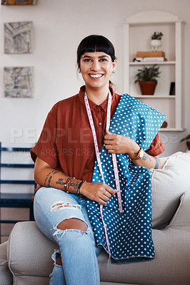 Buy stock photo Shot of a clothes maker posing with fabric at home
