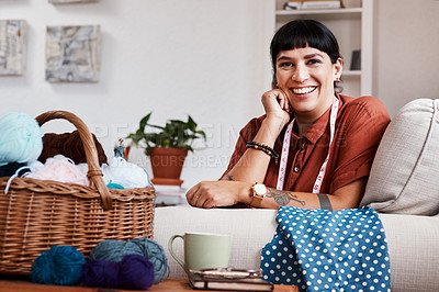 Buy stock photo Cropped shot of a clothing designer relaxing at home