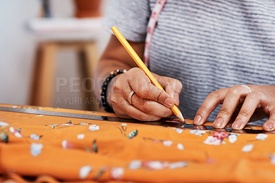 Buy stock photo Cropped shot of a young woman designing a garment at home