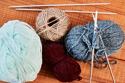 Buy stock photo Still life shot of multi colored woolen balls and knitting pens on a wooden table