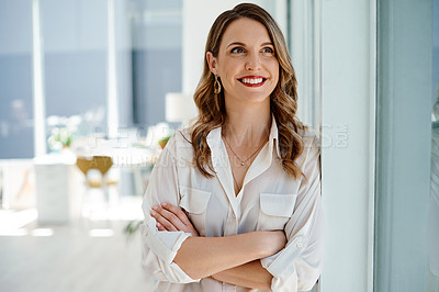 Buy stock photo Cropped shot of an attractive young businesswoman posing with her arms folded inside her office