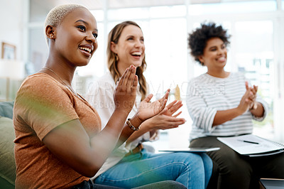 Buy stock photo Shot of a group of businesswomen applauding in an office