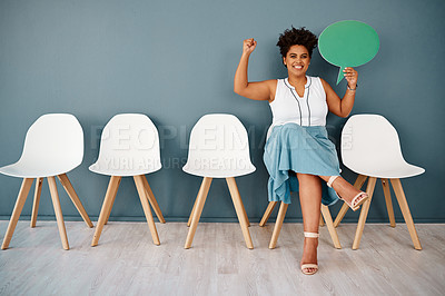 Buy stock photo Studio portrait of an attractive young businesswoman cheering while holding up a speech bubble against a grey background