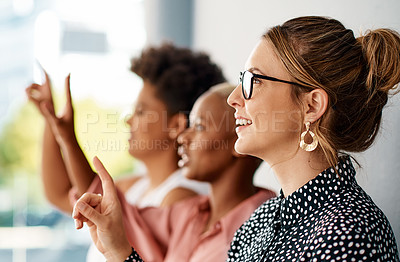 Buy stock photo Cropped shot of a group of attractive young businesswomen raising their hands to ask a question during a conference