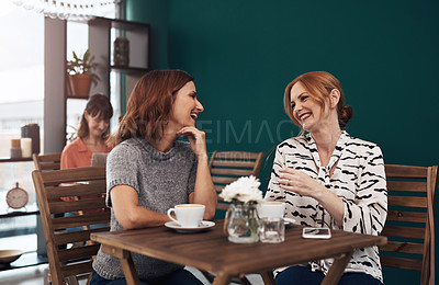 Buy stock photo Cropped shot of two attractive middle aged women having a coffee date together as friends inside of a coffee shop during the day