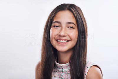 Buy stock photo Cropped portrait of an attractive teenage girl standing alone against a white background in the studio