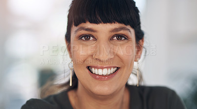 Buy stock photo Cropped portrait of an attractive young businesswoman sitting alone in her office during the day