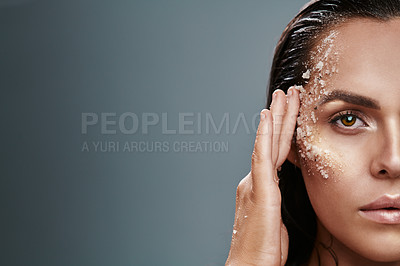 Buy stock photo Shot of a beautiful young woman posing with salt on her face