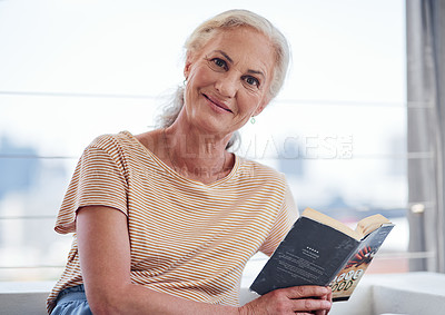 Buy stock photo Cropped portrait of an attractive senior woman reading a book while relaxing on her balcony at home