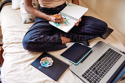 Buy stock photo High angle shot of an unrecognizable female university student painting in a notebook in her room