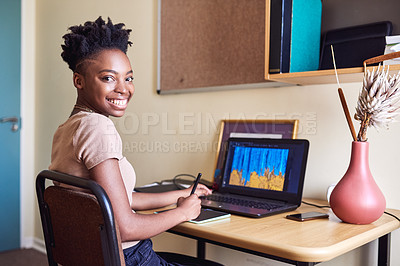 Buy stock photo Cropped portrait of an attractive young female university student using a drawing pad to draw on her laptop in her room