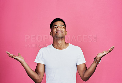 Buy stock photo Cropped shot of a handsome young man standing alone against a pink background in the studio
