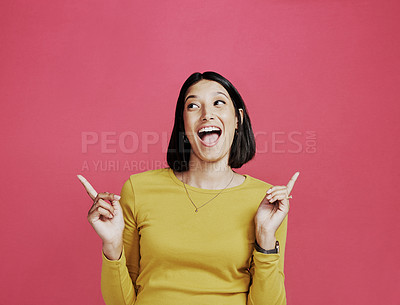 Buy stock photo Cropped shot of an attractive young woman standing and making a hand gesture against a pink background in the studio