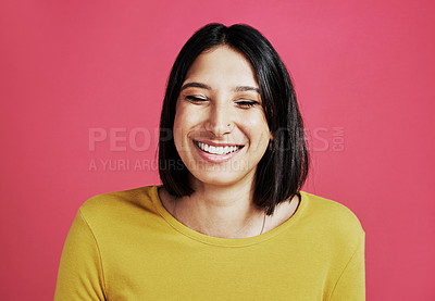 Buy stock photo Cropped shot of an attractive young woman standing alone against a pink background in the studio