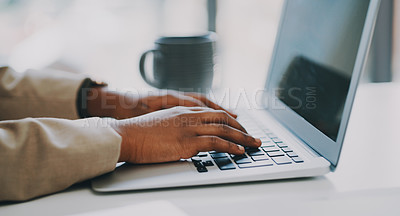 Buy stock photo Closeup shot of an unrecognisable businesswoman using a laptop in an office