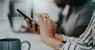 Buy stock photo Closeup shot of an unrecognisable businesswoman using a cellphone in an office
