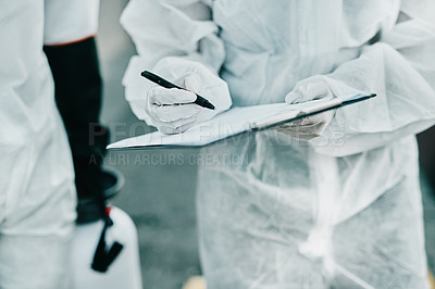Buy stock photo Shot of healthcare workers wearing hazmat suits working together to control an outbreak