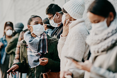 Buy stock photo Shot of a young man and woman wearing masks while travelling in a foreign city