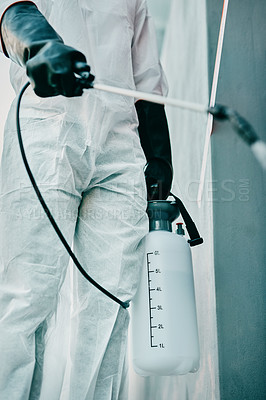Buy stock photo Cropped shot of a healthcare worker wearing a hazmat suit working to control an outbreak