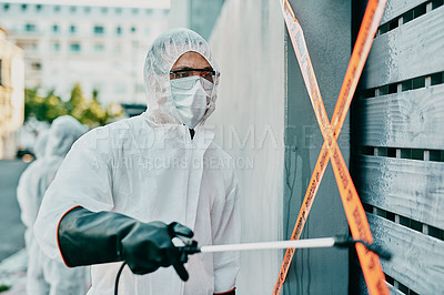 Buy stock photo Shot of a young healthcare worker wearing a hazmat suit working to control an outbreak