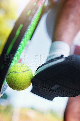 Buy stock photo Cropped shot of an unrecognizable tennis player kicking a tennis ball against a racket on a tennis court outdoors