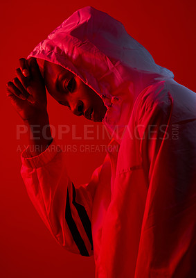 Buy stock photo Red filtered shot of a sporty young posing in the studio