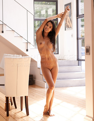 Buy stock photo Nude shot of an attractive young woman at home