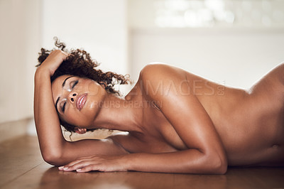 Buy stock photo Shot of an attractive young woman posing sensually indoors