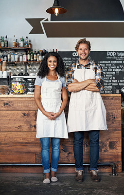 Buy stock photo Cropped shot of partners standing together in their cafe