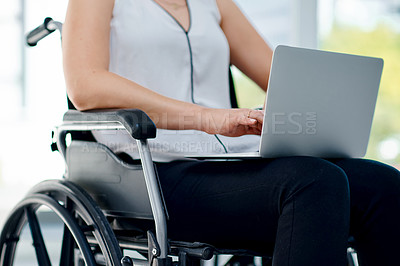 Buy stock photo Cropped shot of an unrecognizable businesswoman using her laptop in the office
