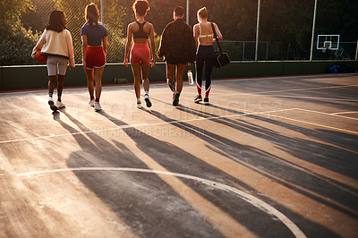 Buy stock photo Rearview shot of an unrecognizable group of friends walking away together after playing a game of basketball