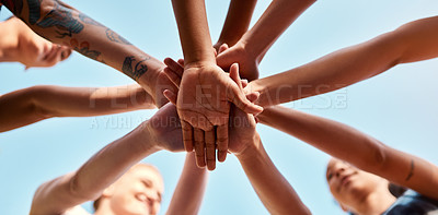Buy stock photo Low angle shot of an unrecognizable group of sportswomen piling their hands together before a basketball game