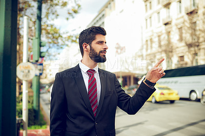 Buy stock photo Shot of a young businessman pointing to something in the city