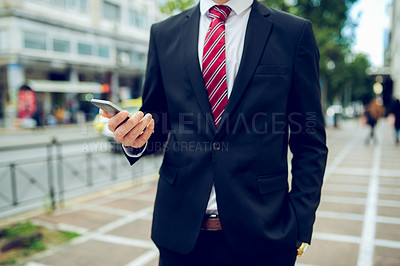 Buy stock photo Closeup shot of an unrecognisable businessman using a cellphone in the city