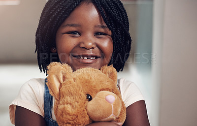 Buy stock photo Portrait of an adorable little girl holding her teddy bear at home