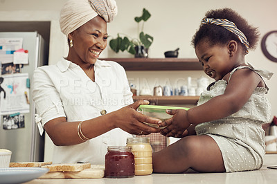 Buy stock photo Portrait of an adorable baby girl helping her mother prepare a lunch meal in the kitchen at home