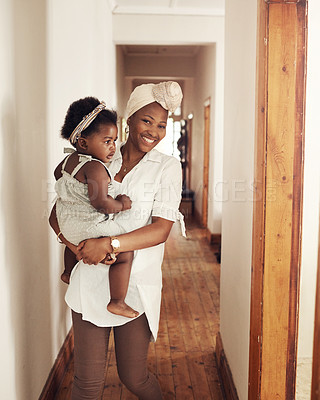 Buy stock photo Cropped shot of an adorable baby girl bonding with her mother at home