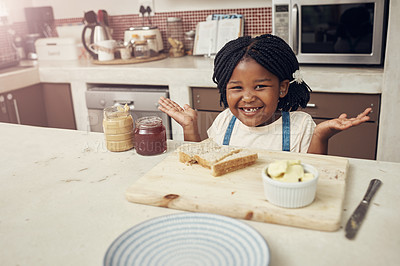 Buy stock photo Portrait of an adorable little girl making lunch for herself in the kitchen at home