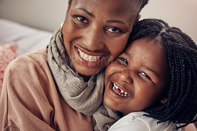 Buy stock photo Portrait of an adorable mother and daughter bonding together at home