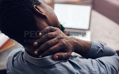 Buy stock photo Cropped shot of a handsome young male architect suffering with neck pain while working in a modern office