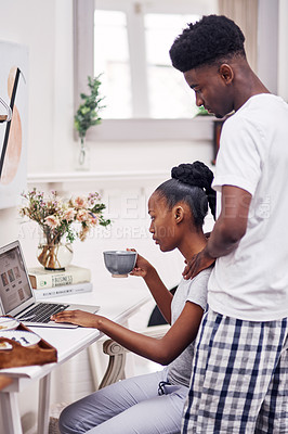 Buy stock photo Shot of a young man interrupting his girlfriend while  working on her laptop at home
