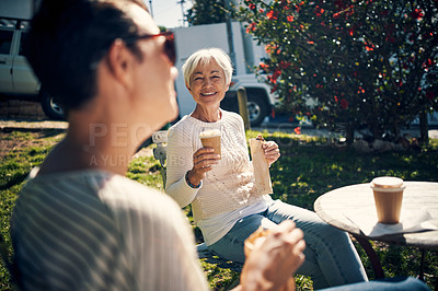 Buy stock photo Cropped shot of a senior woman having lunch and bonding with her adult daughter outdoors