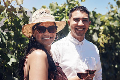 Buy stock photo Shot of a young couple out on a date at a vineyard