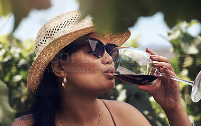 Buy stock photo Cropped shot of a beautiful young woman having a glass of wine outdoors