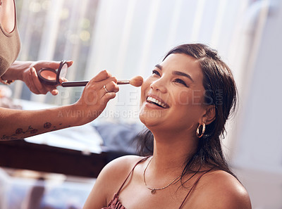 Buy stock photo Cropped shot of a beautiful young woman getting her makeup done