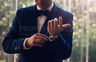 Buy stock photo Cropped shot of an unrecognizable   man getting dressed on his wedding day
