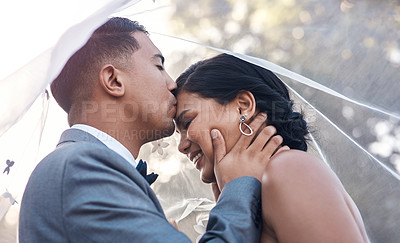 Buy stock photo Shot of a young man kissing his bride on her forehead