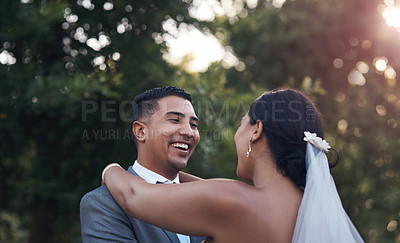 Buy stock photo Cropped shot of an affectionate couple standing outside on their wedding day