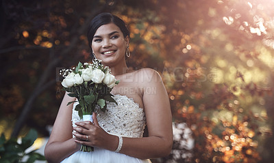 Buy stock photo Cropped shot of a young bride posing outside with her bouquet