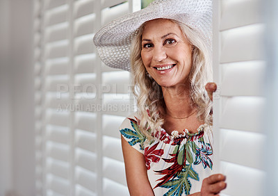 Buy stock photo Cropped portrait of an attractive senior woman smiling while standing indoors on a summer's day